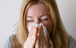 Woman Blowing Nose Allergies Lakelands Acupuncture